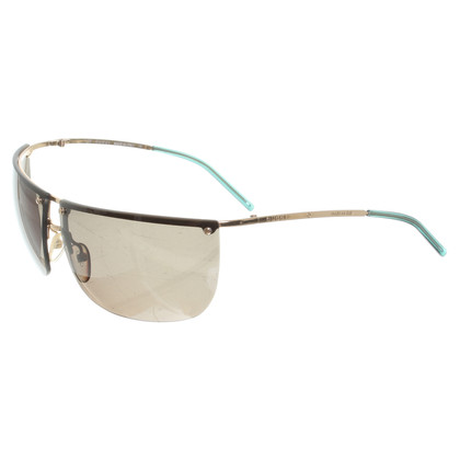 Gucci Sunglasses with green tinted glasses