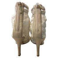 Dolce & Gabbana Bottines peep toe à la crème