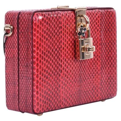 """Dolce & Gabbana """"Mama clutch"""" made of snakeskin"""