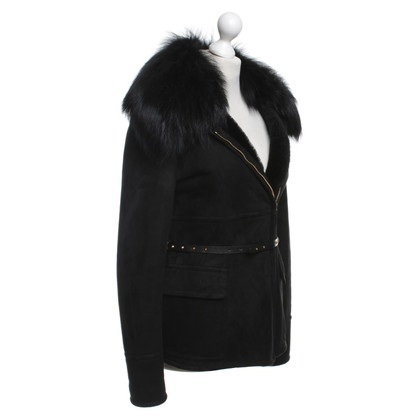 Gucci Wild leather jacket with fur trim