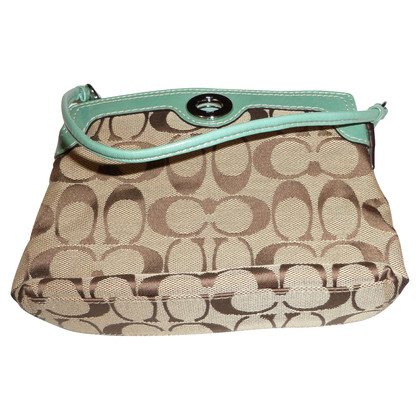 Coach Handbag with logo pattern