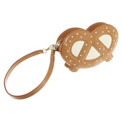 Kate Spade clutch in pretzel shape