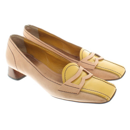 Prada pumps in beige / yellow
