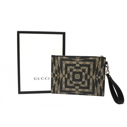 Gucci clutch from GG Supreme canvas