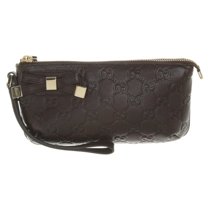 Gucci clutch with logo embossing