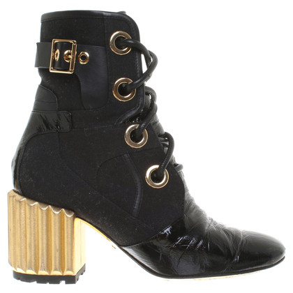 Christian Dior Ankle boots in black / gold