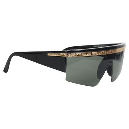 Versace Des lunettes de soleil