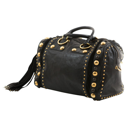 Gucci black  bag with studs and tassel.
