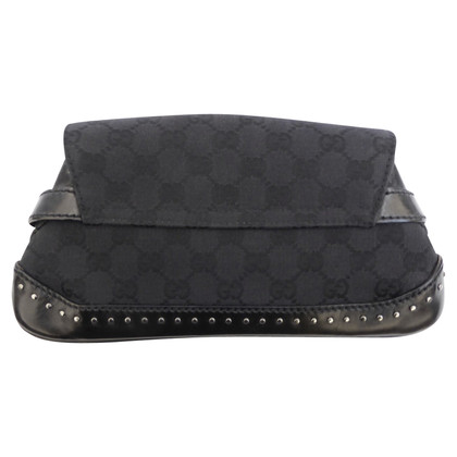 Gucci clutch with buckle closure