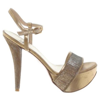 Stuart Weitzman Gouden sandalen