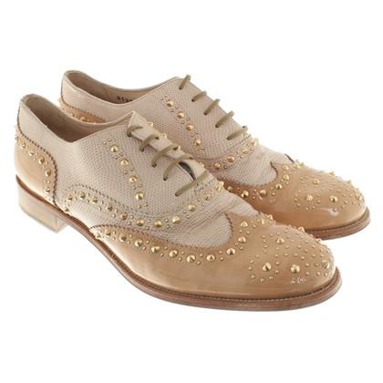 Baldinini Chaussures en cuir avec une application