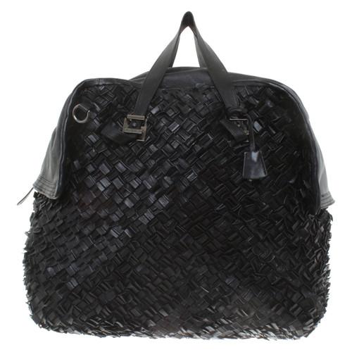 b146f15c6a9e Salvatore Ferragamo Leather travel bag in black - Second Hand ...