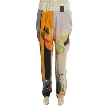 Stine Goya Silk pants with floral pattern
