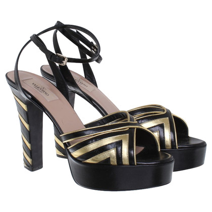 Valentino Sandals in gold / black