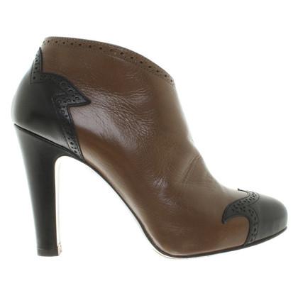 L'autre Chose Ankle boots in bi-color