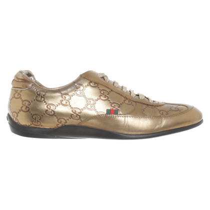 Gucci Gold colored sneakers