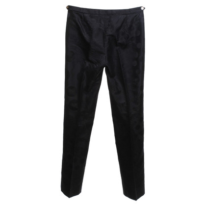 Versace trousers in black