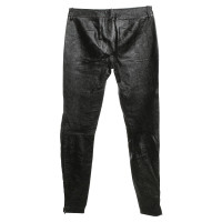 Alexander McQueen trousers in a biker look
