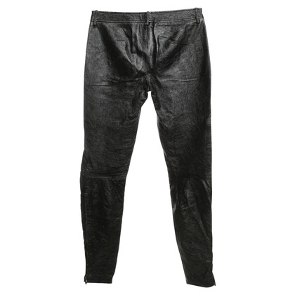 Alexander McQueen trousers in a biker look