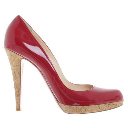 Christian Louboutin pumps in het rood