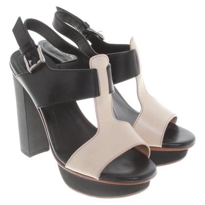Tod's Sandals in cream / black
