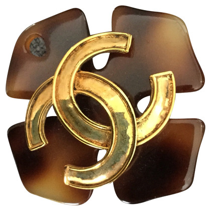 Chanel Broche met logo