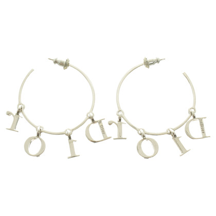 Christian Dior Hoepel oorbellen in zilver Toon