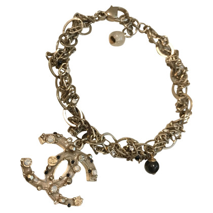 Chanel Gold colored bracelet with logo pendant