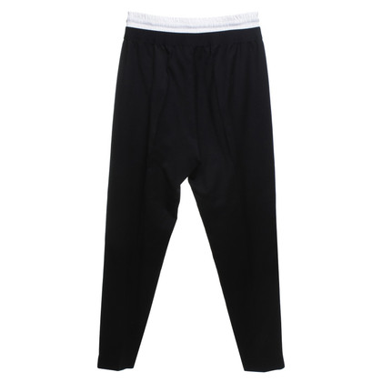 Sandro trousers in black
