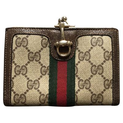 29990bbe64fec Gucci Täschchen Portemonnaie aus Leder in Braun