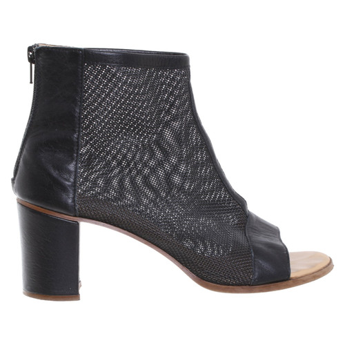 separation shoes 79e0e 99d14 MM6 by Maison Margiela Stivaletti in Nero - Second hand MM6 ...