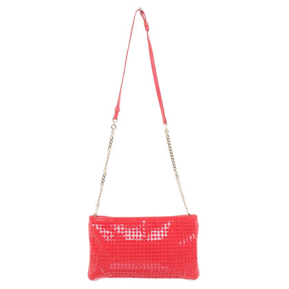 Christian Louboutin Lacklederclutch met klinknagels