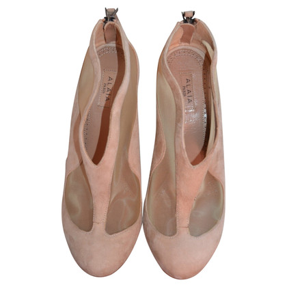 Alaïa pumps in nude