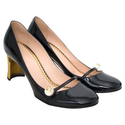 Gucci pumps in patent leather
