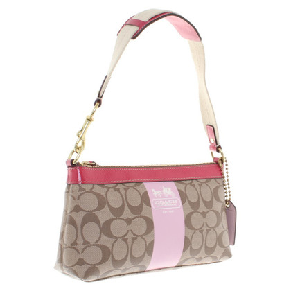 Coach Handbag with logo pattern