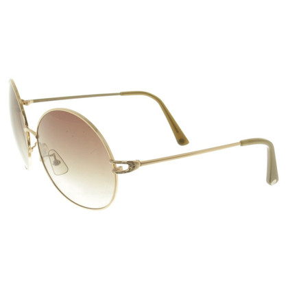 Calvin Klein Sunglasses in ocher / gold