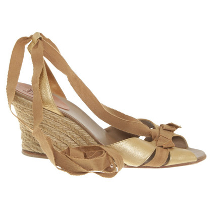 Christian Louboutin Gold colored wedges