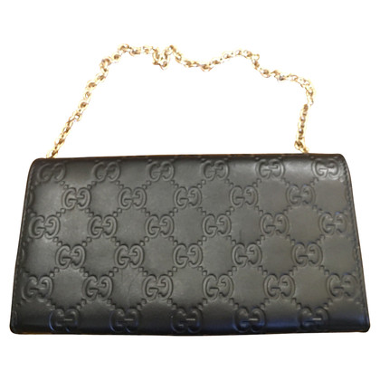 Gucci clutch with Guccissima pattern