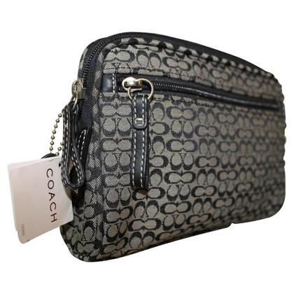 Coach clutch with logo pattern
