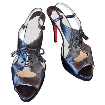 Christian Louboutin Black tasseled lace-up platform sandals