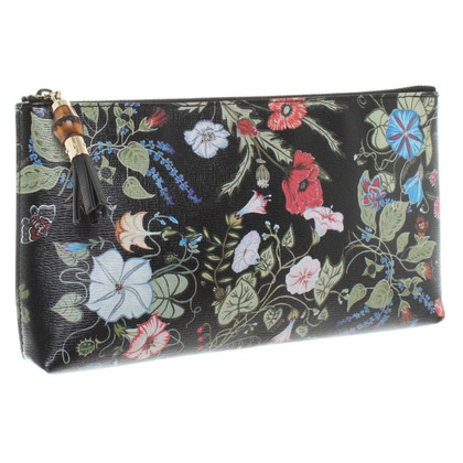 Gucci clutch with floral pattern
