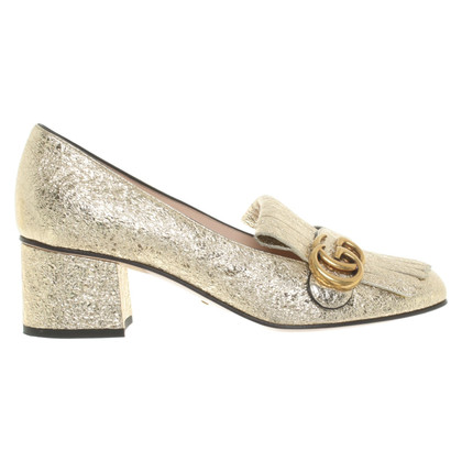 Gucci pumps in goud