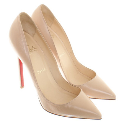Christian Louboutin pumps leer