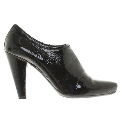 Prada Laced leather ankle boots in black