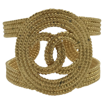 Chanel Gold-colored bangle with logo