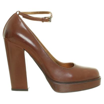 Prada Peep toe pumps in Brown