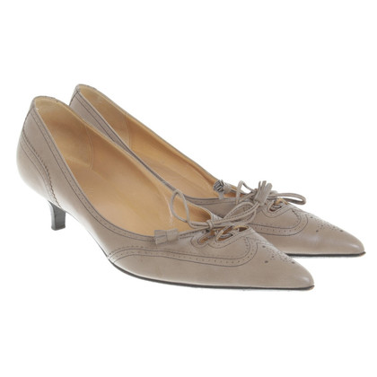 Hermès pumps in taupe