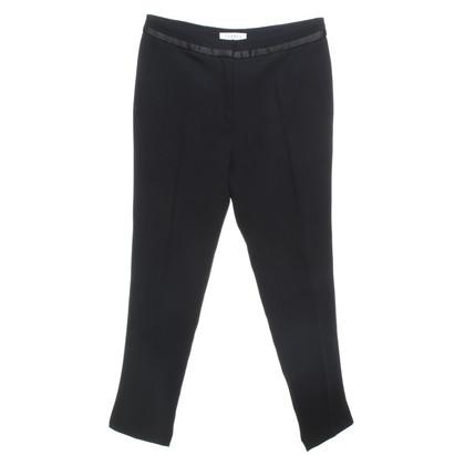 Sandro trousers in black