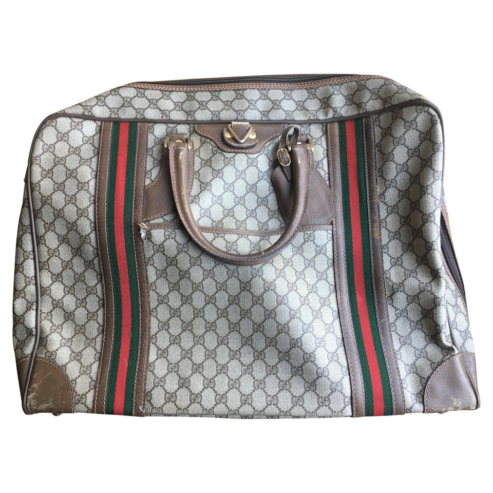 Gucci Suitcase with pockets and hangers