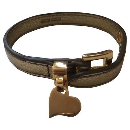 Miu Miu Leather bracelet with heart pendant
